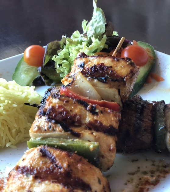 Chargrilled chicken shish kebab with rice and salad